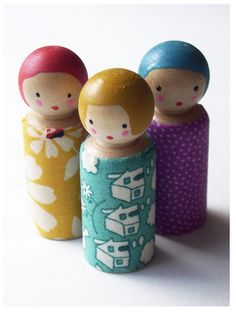 Peg dolls with fabric wrapped around their bodies.  Great idea for using pretty, but tiny scraps.