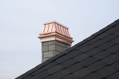 Beautiful and timeless, French Country UL listed, copper, Temptress chimney shroud cap and Chancellor enhanced chase pan flashing.