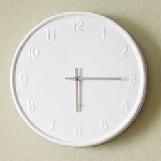 This wall clock from West Elm would look fab in a colorful kitchen with white accents!