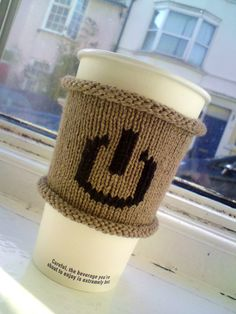Reboot design on a Coffee Cozy found for sale on Etsy.  Thinking about translating into a sewing project.  Geek Speak