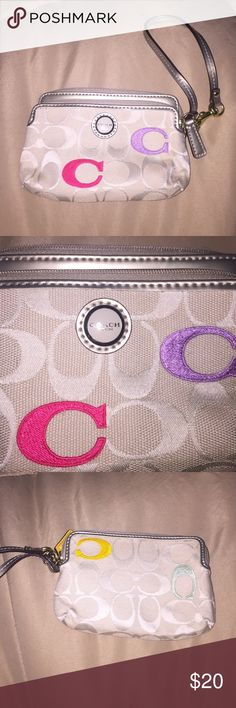 Coach wristlet This beautiful Coach wristlet has two zippered sections and card pockets. It is a light cream color with colored accent C's. The strap and top are a metallic pewter color. The inside is a pretty mint green. This wristlet is in perfect condition.  Great for spring!!! Coach Bags Clutches & Wristlets