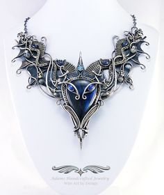 """""""Draco Volanti"""" -- Labradorite Focal with Twin Star Sapphire 'Eyes' & a Swiss Blue Topaz faceted gemstone along w/ sapphire & labradorite beads. All in .999 fine silver."""