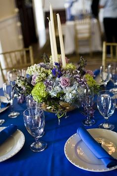 Sapphire blue wedding table settings. Every table was different by Island Gardener, via   http://wedding.lemoncoin.org