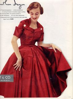 A gorgeous cranberry red ball gown from the 1950s.  How I wish we could dress like this all the time!
