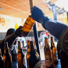Alcohol remains a killer on the country's roads, and despite government proposals to curb drinking holes, taverns continue to flourish. Alcohol And Drug Abuse, Stalls, Flourish, Beer Bottle, Drinking, Soda, Drink, Drinks