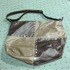 I just added this to my closet on Poshmark: REDUCED! *Studded Chocolate & Tan Shoulder Bag*. Price: $10 Size: OS