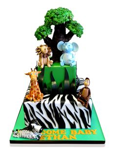 Animal Themed Cake  This fun cake was made for Baby Ethan and featured a wild animal theme which our cake artists had great fun making! The occasion catered for 50 people and we filled the two tier cake with a scrumptious filling of vanilla in the top tier and vanilla meringue butter cream in the lower tier. http://cmnycakes.com/gallery2/v/Cakes+For+All+Occasions/Animal+Themed+Cake.html?