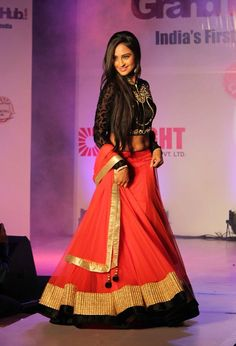 Krystal D'Souza in gorgeous red and black contrast lehenga with gold trimings