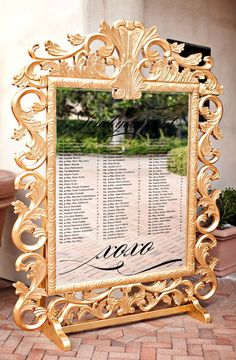 What a stunning gold, mirrored seating chart! Glamorous wedding planned by Intertwined Events at The Resort at Pelican Hill, photo by APictureLife Photography | junebugweddings.com