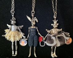 I'm teachinga class on fairy tales--classic and revisionist--so it's no surprise that I was drawn to these cunning necklaces from the Par...