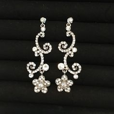 Floral formal earrings Beautiful earrings, perfect for any spring event! Only worn once. Originally bought at Macy's. Fantastic condition, no loose stones, no scratches, and no discoloration. I'm open to offers! Thank you and have a wonderful day! Macy's Jewelry Earrings