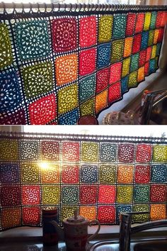 This colorful crochet curtain looks so cheerful in a kitchen window.: