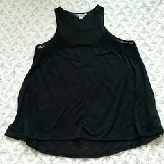 Black AEO Racerback Tank Casual tank will pair well with shorts or a jean skirt!  Pre loved (you can tell it has been washed) with no holes, stains, or pilling. Non smoking home. American Eagle Outfitters Tops Tank Tops