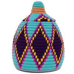 These colourful storage pots are handwoven by Berber tribes in the Sahara Desert, each one completely unique! Originally made to store Khobz bread...
