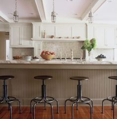 Harbinger designs:  love the long island; industrial pendants; stools; cooking alcove; coffered ceiling