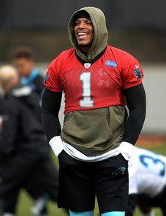 Carolina Panthers quarterback Cam Newton jokes with his teammates during stretching on Thursday, December 17, 2015.