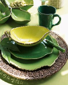 Botanical prints have become more and more popular of late, appearing on everything from wall coverings to textiles to dishware. Ceramic Plates, Ceramic Pottery, Pottery Bowls, Table Verte, Vase Deco, Purple Home, Dish Sets, Dinner Sets, Leaf Shapes