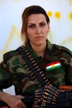 Caption:An Iranian Kurdish female member of the Freedom Party of Kurdistan (PAK) poses for a picture at a training camp in Dibis, some 50 kms northwest of Kirkuk, on September 15, 2014. The world's top diplomats pledged today to support Iraq in its fight against Islamic State militants by 'any means necessary', including 'appropriate military assistance', as leaders stressed the urgency of the crisis. AFP PHOTO/SAFIN HAMED (Photo credit should read SAFIN HAMED/AFP/Getty Images)