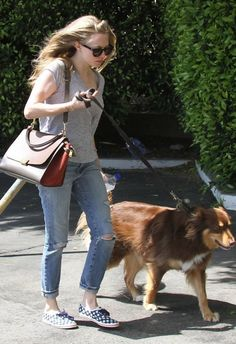 13 Ways to Style Flat Sneakers via Brit + Co. Casual Outing: Hey, celebrities wear Keds to take their dogs for walks, too! While strolling with her pup, Amanda Seyfried casually paired her gingham Keds with distressed jeans and a grey tee. (via Denimology)