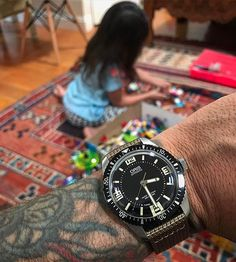 REPOST!!!  #wisdads #sunday with legos and the #oris 65 diver on textile strap. #oris65  repost | credit: ID @rayraythemack (Instagram)