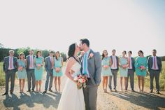 grey, coral, light turquoise <3 I love how the groom and groomsmen have different colored ties
