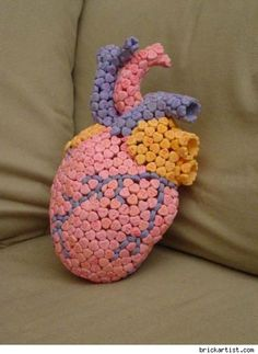 Yup, that's a heart made of converstaion hearts!  Deliciously creepy.