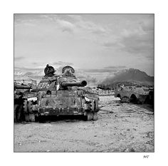"""This picture was taken near Kabul at a """"cemetery"""" of Russian-made tanks. The cemetery commemorates the victims of the Afghan / Soviet war. Tanks cover the hills as far as the eye can see."""