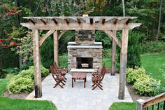 free standing patio in rustic shabby wooden pergola rock fireplace natural stone paving floors dark toned wood furniture of Turn Your Backyard into Inviting Spot just with These Pergola Designs for Patio