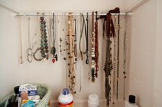 Got this idea from Pinterest and did it myself at home - the easy necklace organizer: purchase a small tension rod and place it in your closet, hang your necklaces; and you're done!  you can see all your necklaces at once.  I might repeat this with my bracelets as well.