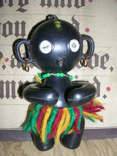 Vintage, black, winking doll, soft plastic, made in Hong Kong. I remember winning these in fairgrounds (especially Blackpool Pleasure Beach) in the 70's. They had holographic (is that the word?) winking eyes.