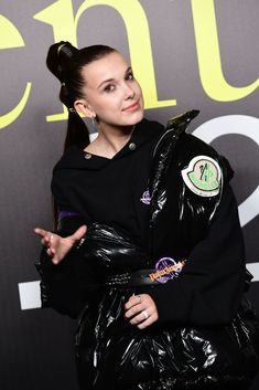 British actress Millie Bobby Brown poses during a photo call as she. - British actress Millie Bobby Brown poses during a photo call as she arrives to attend the Moncler w - Millie Bobby Brown, Moncler, Bobby Brown Stranger Things, Browns Fans, British Actresses, Looks Style, Celine Dion, Autumn Winter Fashion, Fall Winter