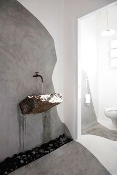 stone basin in minimalist bathroom