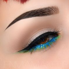 Heavy winged liner with green lower shadow and electric blue lashes #eye #makeup #eyes #eyeshadow #bright #bold #dramatic