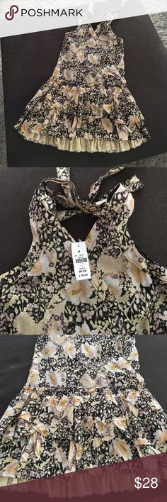 """Dahlia Floral Print Top This is a very interesting top or it can be a mini dress on a shorter person. Got this on sale tag says one size but it's seriously not one size more like a small/med. It is a tie back. There is a snap button at the front for closure but not even needed. Front length 31"""", drop waist, across bust 15"""". I love the print but I'm sure some one else can pull off this look. Lined, two layered bottom with lace along the edges. Dahlias Tops Tunics"""