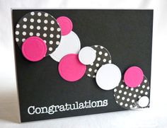 handmade card  ... loads of circles ... focal point is the line of circles in various sizes ...black  white with pops of hot pink ...