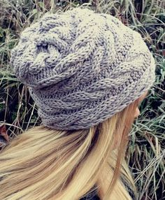 Free Knitting Pattern for Easy Knit Flat Cable Wrap Beanie - Knit flat and seamed. Slouchy hat knit sideways so the cables run horizontally around your head, almost like a scarf, with the cables making a natural slouch. Designed by Katrine Hammer. Rated easy by Ravelrers.