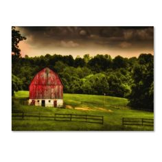 This ready to hang, gallery-wrapped art piece features a red barn in a green…