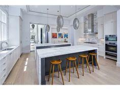 Coastal contemporary kitchen.  Cool silver pendant lights.  Olde Naples beach house | 14th Avenue South | Naples, Florida
