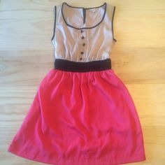 Gianni Bini Dress ❤️ So pretty! Elastic waist for a great fit. Peek a boo back but can still wear regular bra with it. Fully lined. Pink lower. Cream upper with black trim. Cute black buttons. Perfect condition. Size xs but I'm a true small and it also fits me well. Gianni Bini Dresses