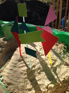 Sandpit castle flags made from straws and paint sample cards (finally did something with them!)