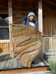 Donna Crispin with Oregon landscape tapestry