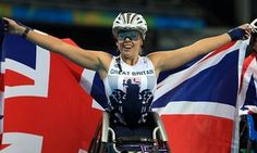 ParalympicsGB's Hannah Cockroft celebrates after winning the Women's 400 metres T34 final in a world record time.