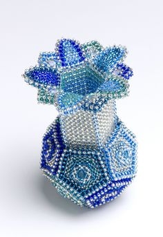 From knitted pentagonal bottle on with beads. No directions, but beautiful…