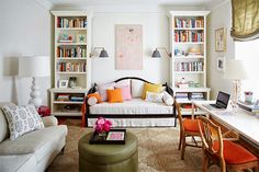 Daybed between bookcases, love seat, workspace