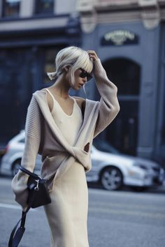 Add a cozy knit to a slip dress to make it appropriate for day