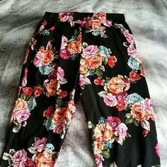 Floral Print Joggers Lightweight (100% polyester) floral printed jogger pants worn on only 2 occassions. Very comfortable. Features elastic bands at the waist and stylishly draped pockets in the front, fitted at the ankles. I purchased this in a boutique and I'd say the sizing is for young women / teens rather than women's sizing unless you have a petite figure. Ambiance Apparel Pants Track Pants & Joggers