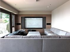 Such a sleek viewing room! The av equipment in this home theater doesn't impede on the decor at all!
