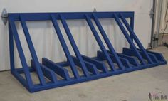 """Creative DIY bike storage racks to solve the """"how to store bikes"""" question! These DIY bike racks are inexpensive to make and are simple projects! Wood Bike Rack, Diy Bike Rack, Bike Storage Rack, Bicycle Rack, Diy Rack, Bike Stand Diy, Bicycle Stand, Garage Velo, Diy Garage"""