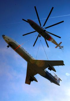 Soviet Mi-26 helicopter carries a Soviet TU-134 aircraft. The Mi-26 is the largest and most powerful production helicopter.