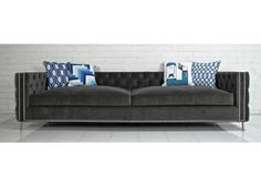 """This new sofa show their colors, and details both inside and out featuring tufted charcoal velvet, chrome nail heads and metal legs. 42"""" Deep / 28"""" Tall / 112"""""""